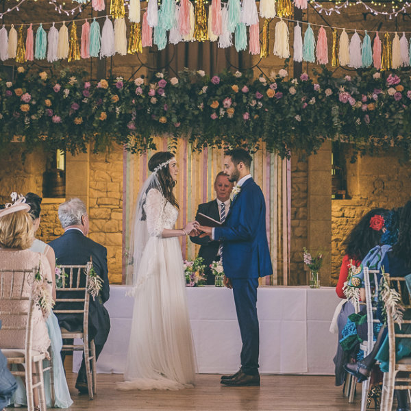 Married couple surrounded by wedding flowers